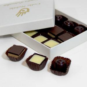cioccolatini con olio di raggia, rosciola e mignola